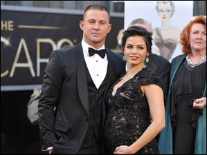 Actors Channing Tatum, left, and Jenna Dewan-Tatum arrive at the 85th Academy Awards.