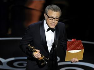 "Actor Christoph Waltz accepts the award for best actor in a supporting role for ""Django Unchained"" during the Oscars on Sunday in Los Angeles."