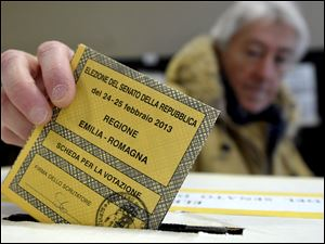 A man casts his vote for the Italian Senate, in Piacenza, Italy, Sunday.