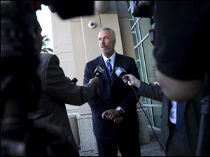 Clark County District Attorney Steve Wolfson, framed by reporters, speaks with media after a news conference releasing information about last week's deadly shooting and subsequent car crash on the Las Vegas Strip at Las Vegas police headquarters in Las Vegas.