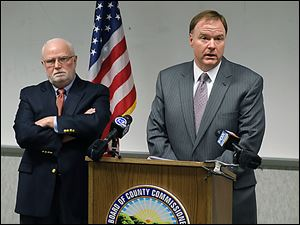 Jim Ruvolo, left, and Jon Allison recommend an overhaul of the Lucas County Board of Elections operating procedures.