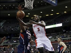Detroit Pistons guard Rodney Stuckey (3) shoots a layup against Atlanta Hawks center Al Horford (15)  during the second half of an NBA basketball game at the Palace inAuburn Hills.