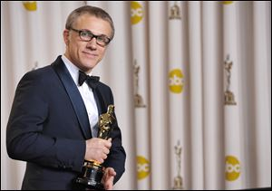 "Actor Christoph Waltz poses with his award for best actor in a supporting role for ""Django Unchained."" Waltz beat out a trio of presumptive favorites: Alan Arkin (Argo), Robert De Niro (Silver Linings Playbook), and Tommy Lee Jones (Lincoln)."