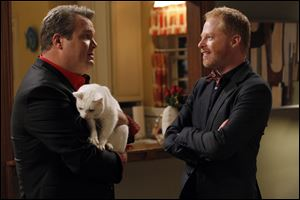 "Eric Stonestreet, left, and Jesse Tyler Ferguson in a scene from the ABC hit show ""Modern Family."""