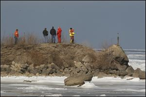 Authorities search for a man thought to have fallen through the ice in Lake Erie near Oak Harbor.