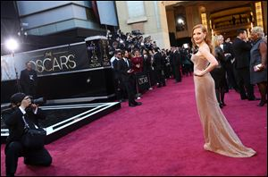 Actress Jessica Chastain arrives Sunday at the Oscars in a Giorgio Armani dress.