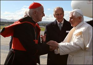 Pope Benedict XVI, right, is greeted by  Cardinal Keith O'Brien  in Edinburgh, Scotland, in September, 2010.