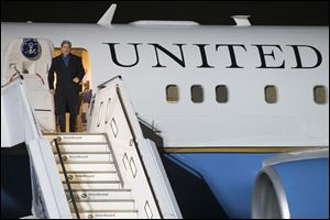US Secretary of State John Kerry leaves the plane after his arrival in Germany today.