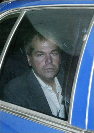 John Hinckley Jr. arrives at U.S. District Court in Washington. Hinckley, the man who shot President Ronald Reagan is back in court for hearings on whether he should get to spend more time away from the psychiatric hospital where he has been living.