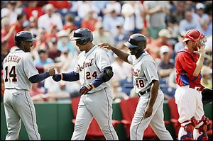 Detroit's Miguel Cabrera (24) celebrates with Austin Jackson (14) and Torii Hunter after hitting a three-run home run.