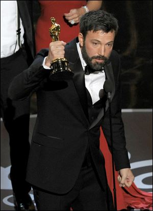 Ben Affleck accepts the award for best picture for
