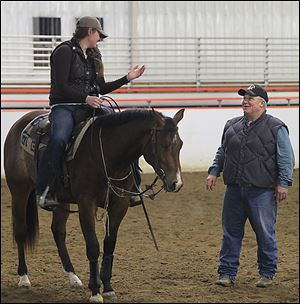 University of Findlay student Bekah Irish speaks with riding instructor Art O'Brien. At present, 184 students — 114 in western riding and 70 in English riding — are enrolled in the program at the Hancock County institution.