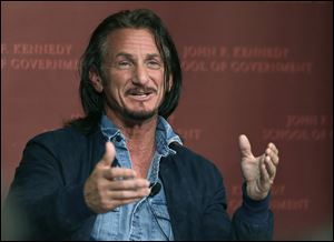 Actor-director Sean Penn gestures as he participates in a discussion at Harvard University's John F. Kennedy School of Government today in Cambridge, Mass.