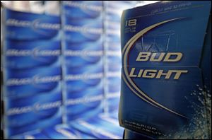 Beer lovers across the country have filed $5 million class-action lawsuits accusing Anheuser-Busch of watering down its Budweiser, Michelob and other brands.