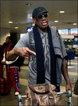 Former NBA star Dennis Rodman speaks at the departure hall of Beijing Capital International Airport in Beijing as he and three members of the Harlem Globetrotters basketball team, a VICE correspondent and a production crew from the company are visiting North Korea to shoot footage for a new TV show set to air on HBO in early April.