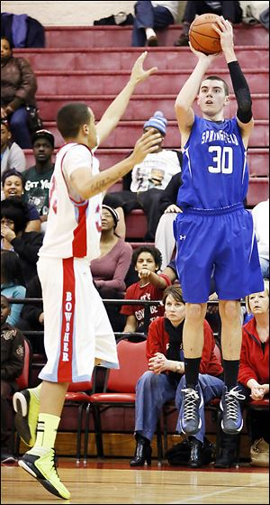 Springfield's Dilyn Good, right, takes a shot against Bowsher's Marcus McGovern. Good scored a game-high 18 points — including three 3-pointers — as the Blue Devils won.