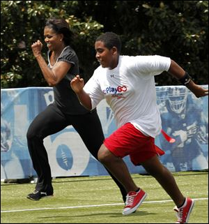First lady Michelle Obama runs a 40-yard sprint during the Let's Move! Campaign and the NFL's Play 60 Campaign festivities with area youth, to promote exercise and fight childhood obesity, in New Orleans in September, 2010.