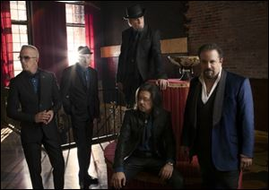 From left, Paul Deakin, Jerry Dale McFadden, Robert Reynolds, Eddie Perez (seated), and Raul Malo of the Mavericks.