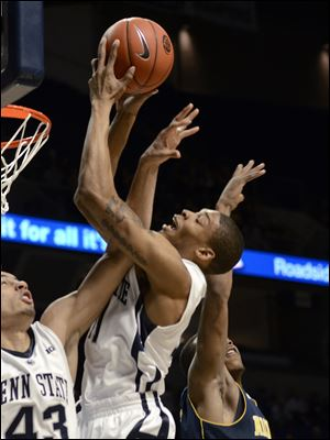 Penn State's Jermaine Marshall pulls down a rebound between teammate Ross Travis, left, and a Michigan defender during the first half today in State College, Pa.