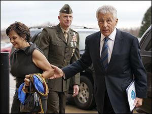 Marine Corp. Lt. Gen. Tom Waldheuser, center, greets Sen. Chuck Hagel, (R., Neb.), right, and his wife Lilibet, as they arrive at the Pentagon to be sworn-in as Secretary of Defense.