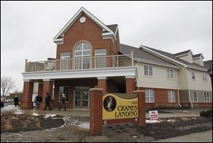 Visitors tour the Crane's Landing independent senior apartment complex on Chase Street in Toledo, following a grand opening ceremony, today.