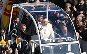 Pope Benedict XVI greets pilgrims in St. Peter's Square at the Vatican, today, for the final time before retiring, waving to tens of thousands of people who have gathered to bid him farewell.