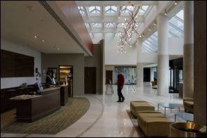 A valet crosses the lobby of the new Best Western Premier Hotel in downtown Toledo. The hotel was former the Grand Plaza Hotel.
