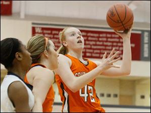 Southview's Emily Westphak (42) drives the lane to put up two points during the third quarter.