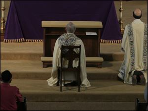 Bishop Leonard Blair during the Eucharistic Adoration.