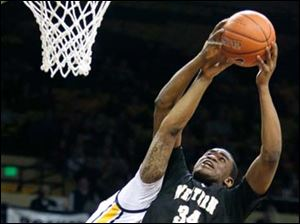 Western Michigan forward A.J. Avery (34) pulls in a rebound against University of Toledo forward Reese Holliday (32).