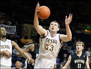 Toledo center Nathan Boothe (53) pulls in a rebound against Western Michigan.