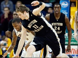 MAC West player of the week Rian Pearson (5) battles Western Michigan's Nate Hutcheson (11) for a loose ball.
