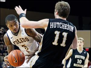 Rockets' guard Rian Pearson (5) plows over Western Michigan forward Nate Hutcheson (11).