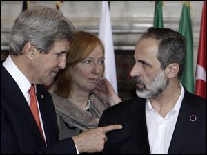 U.S. Secretary of State John Kerry, left, talks to Syrian opposition coalition leader Mouaz al-Khatib, during an international conference on Syria at Villa Madama, Rome, today.