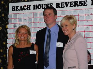 The Beach House Reverse Raffle co-chairmen Katrina Iott and Joe Rosenberg with event emcee Chrys Peterson of WTOL-TV, Channel 11.