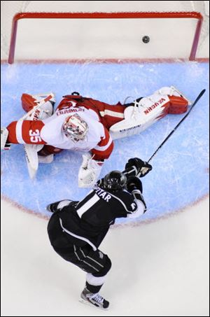 Los Angeles Kings center Anze Kopitar, below, scores on Detroit Red Wings goalie Jimmy Howard during the third period.