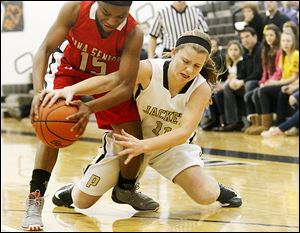 Perrysburg's Mollie Whitacre goes in for a steal of the ball from Lima Senior's Indiya Benjamin during the first half of Thursday's Division I district semifinal. The Yellow Jackets won, 79-64.