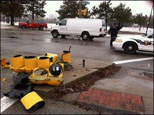 The wreckage of a traffic light rests on the ground on the Anthony Wayne trail near Woodsda