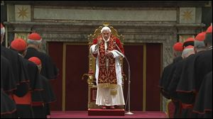 Pope Benedict XVI deliveres his final greetings to the assembly of cardinals at the Vatican today before he officially retires.