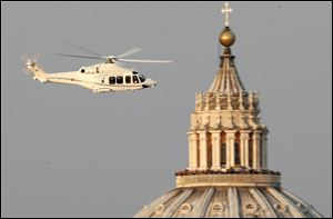 A helicopter with Pope Benedict XVI onboard leaves the Vatican in Rome.