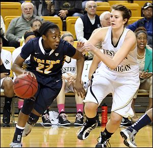 Toledo's Andola Dortch tries to get by Western Michigan's Julia Henson. Dortch finished with 15 as the Rockets cruised to a win.