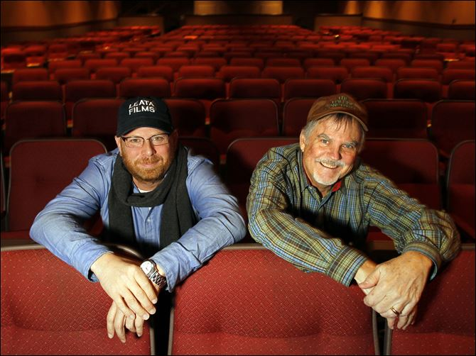"Jason Hamilton, left, and Mike Malone at the Maumee Indoor Theater, where their documentary about Toledo singer/songwriters called ""Playing Nightly"" will premier Tuesday."