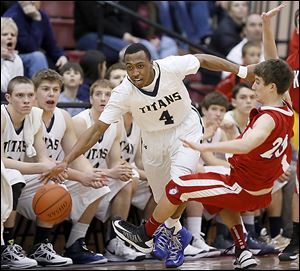 Anthony Glover of St. John's knocks over  Kevin Metzger of St. Francis. The Titans improved to 20-3.
