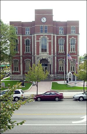 Defiance County Courthouse, shown in 2000, lost much of its historical value, some say, when the top floor was remodeled years ago in a modern style.