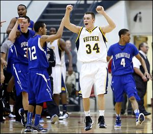 Nate Holley celebrates as Whitmer slips past Springfield in a Division I boys basketball sectional final. A blocked 3-point shot during the final seconds helped the Panthers escape with the victory.