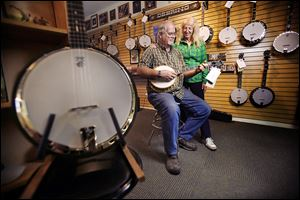Founders Greg and Janet Deering stand in the showroom at the Deering Banjo Co., the best-selling banjo-making business in the United States. The company has expanded its work force and expects to top $4 million in sales for the year ending June 30.