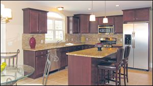 Gourmet kitchen with plenty of counterspace, a large work island with snack bar, and a generous pantry.