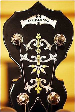 Inlays adorn the headstock of a Deering banjo at the Deering Banjo Co. A banjo can take from three hours to 20 hours to build. No nails are used in an instrument.