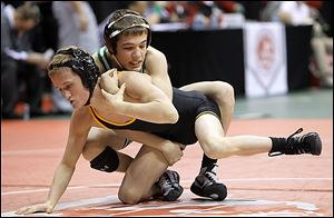 Delta's Jake Spiess, top, beat Black River's Sebastian Vidika 7-1 in the 106-pound semifinals. Spiess (44-4) will wrestle for the title today against Woodmore's Evan Ulinski (49-3).