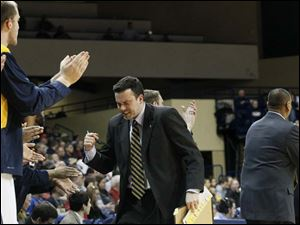 Toledo's assistant coach Ryan Pedon cheers.